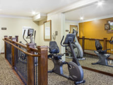 The exersize room shows cardio machines for guest use.