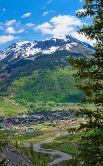 The town of Silverton, CO nestled in the valley during summertime.